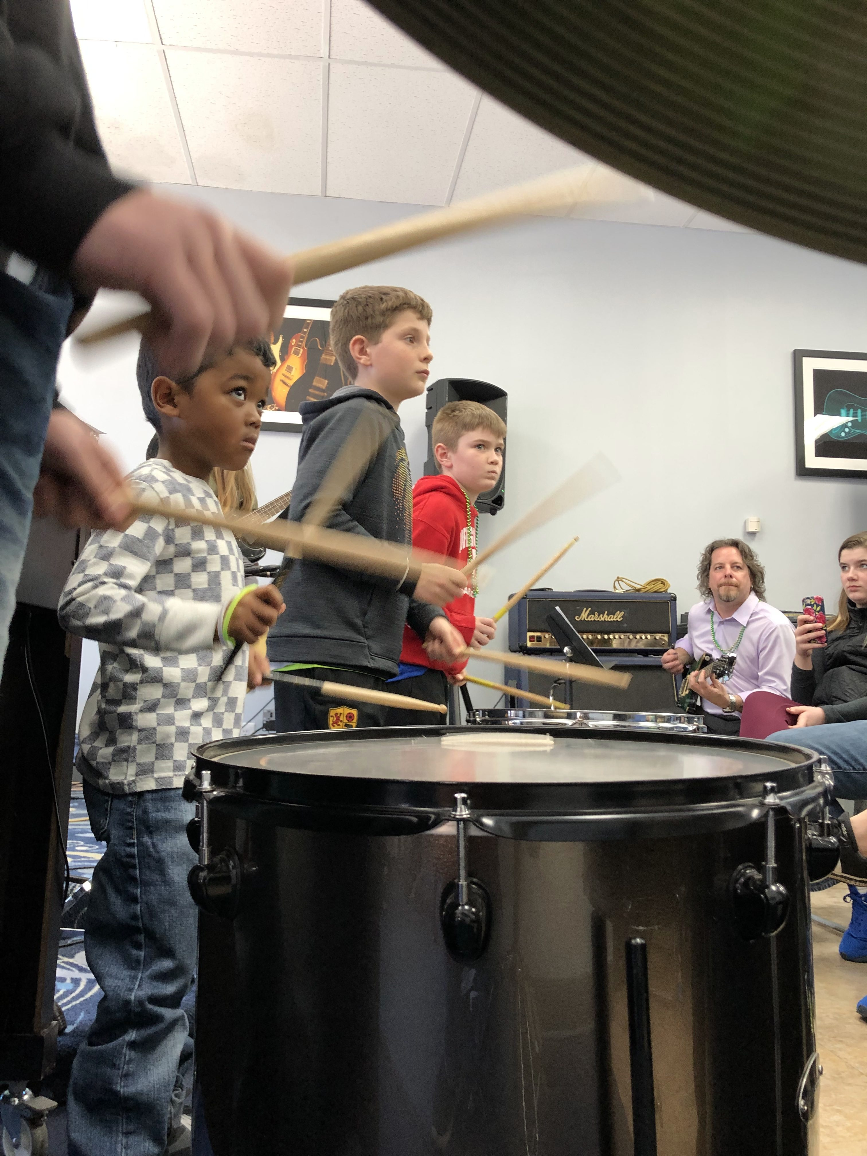 Drum Teacher Janie MacAuslan performing music with students all ages